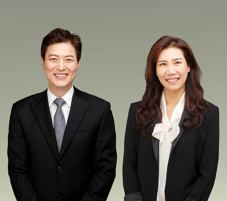 Three dentists smiling together