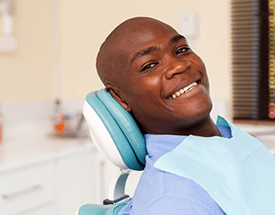 Man with flawless white smile in dental chair