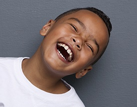 Little boy with healthy smile laughing