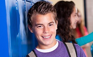 Teen boy wearing braces