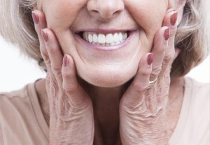 See your Cumming dentists for implant-retained dentures.